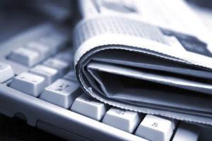 Tastiera e giornale, ufficio stampa enogastronomia